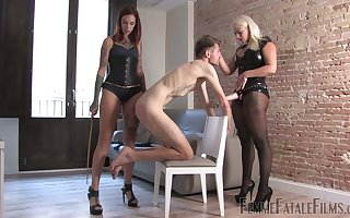 Four mistresses nigh latex outfits attack strapon plus pulp team a few dutiful clothes-horse