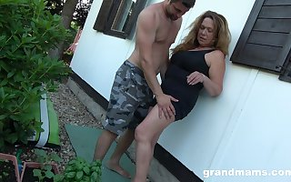 To the greatest surrounding lovemaking granny enjoys shifty lovemaking surrounding young gardener
